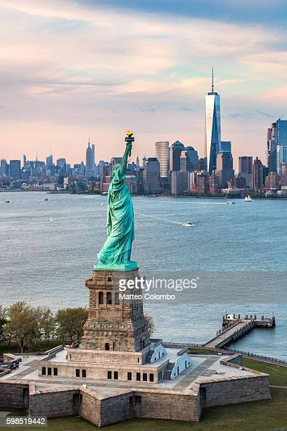 Aerial of the Statue of Liberty at sunset, New York, USA