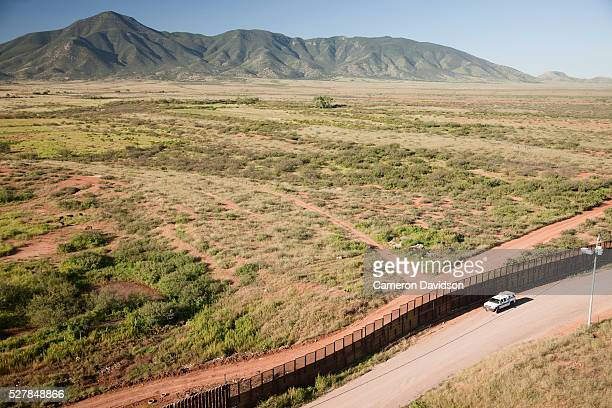 Aerial of the United States/Mexico border fence and US Border Patrol vehicle west of Naco Arizona/Mexico on September 4 2008 in the early morning...