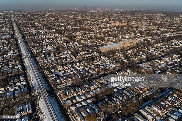 Aerial of train tracks through suburb of Chicago