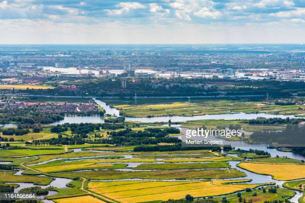 aerial of twiskemolen along zuidwestplas and amsterdam houthavens - merten snijders stock pictures, royalty-free photos & images