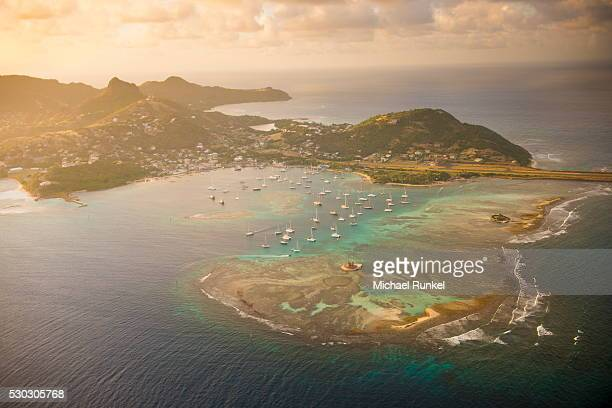 aerial of union island at sunset, the grenadines, st. vincent and the grenadines. windward islands, west indies, caribbean, central america - セントビンセント島 ストックフォトと画像