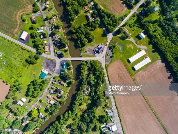 Aerial of village bridge and farm fields