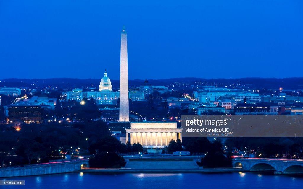 Aerial of Washington D.C. shows Lincoln & Washington Memorial and U.S. Capitol and Memorial Bridge : Stock Photo