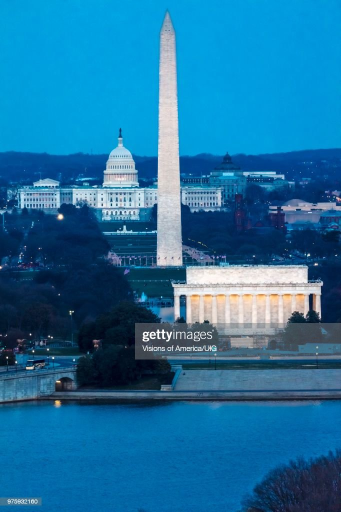 Aerial of Washington D.C. shows Lincoln & Washington Memorial and U.S. Capitol and Memorial Bridge : Stock Photo