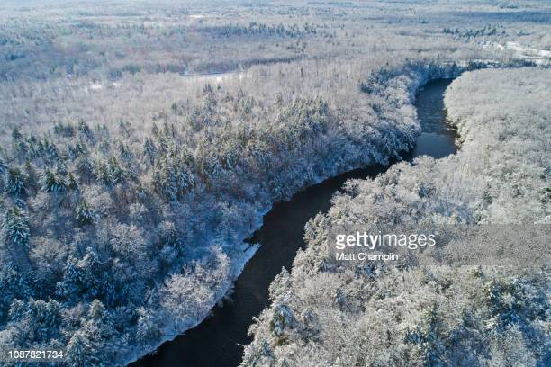 aerial of wild river in winter after fresh snowfall - área silvestre fotografías e imágenes de stock