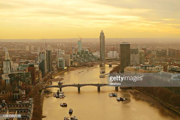 aerial or bird eye view of thames river bridges and tall buildings of the city london, england - passenger craft stock pictures, royalty-free photos & images