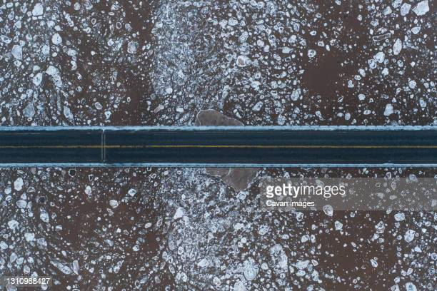 aerial over bridge and ice filled river - canada stock pictures, royalty-free photos & images