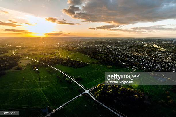aerial over richmond park at sunset - richmond park stock pictures, royalty-free photos & images