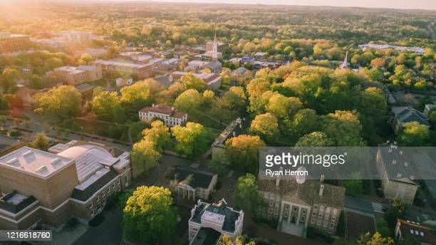 aerial over the university of north carolina in the spring - campus stock pictures, royalty-free photos & images
