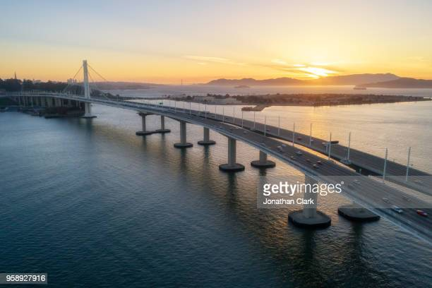 aerial over traffic bay bridge at sunset, san francisco, usa - bay bridge stock pictures, royalty-free photos & images