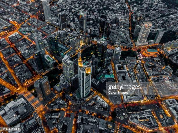 aerial overhead view of frankfurt am main, germany skyline at night with glowing streets - frankfurt stock-fotos und bilder