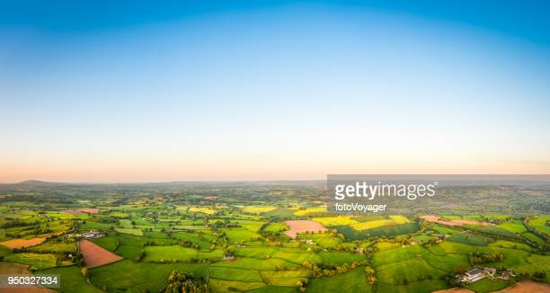 aerial panorama clear blue skies over picturesque green rural landscape - land stock photos and pictures