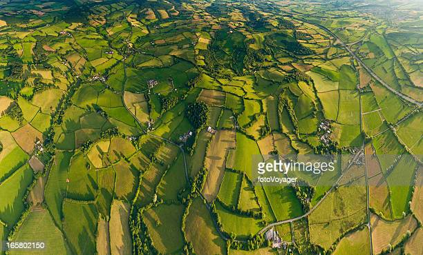 Aerial panorama farms villages vibrant green summer landscape