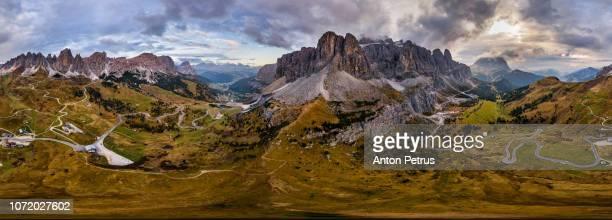 360° aerial panorama in dolomites mountains, passo gardena, italia. timelapse - wide angle stock pictures, royalty-free photos & images