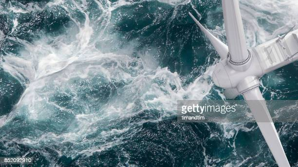 aerial panorama of a close up wind turbine in the sea - wind power stock pictures, royalty-free photos & images