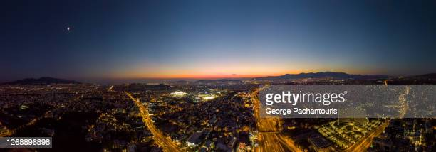 aerial panorama of athens and the olympic stadium at dusk - olympic stadium stock pictures, royalty-free photos & images