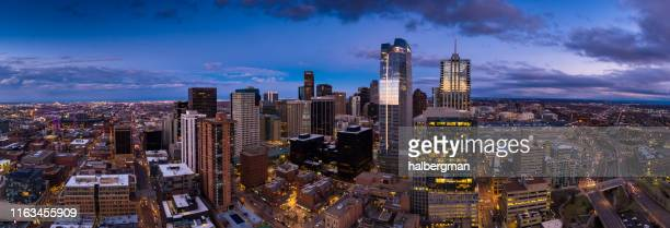 aerial panorama of downtown denver at sunset - denver stock pictures, royalty-free photos & images