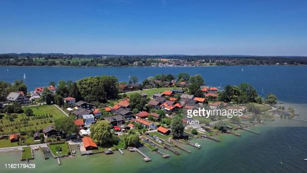 aerial panorama of frauenchiemsee island (fraueninsel) in chiemsee lake, bavaria, germany. - bayern stock pictures, royalty-free photos & images