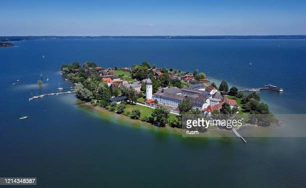 aerial panorama of frauenchiemsee island (women's island) in chiemsee lake, bavaria, germany. - monastery stock pictures, royalty-free photos & images
