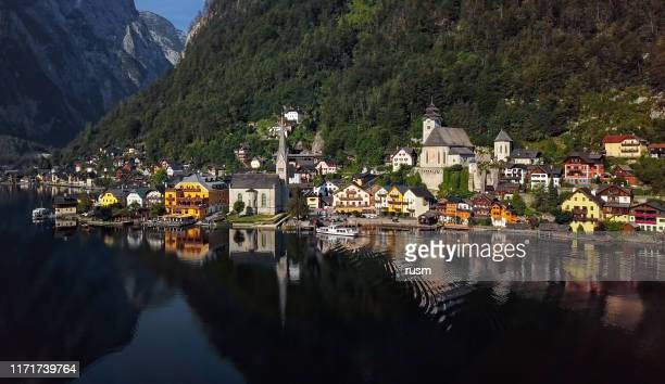 aerial panorama of hallstatt village over calm hallstatter see at sunny summer morning, in salzkammergut, upper austria. - unesco stock pictures, royalty-free photos & images