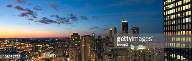 Aerial panorama of illuminated Chicago at sunset