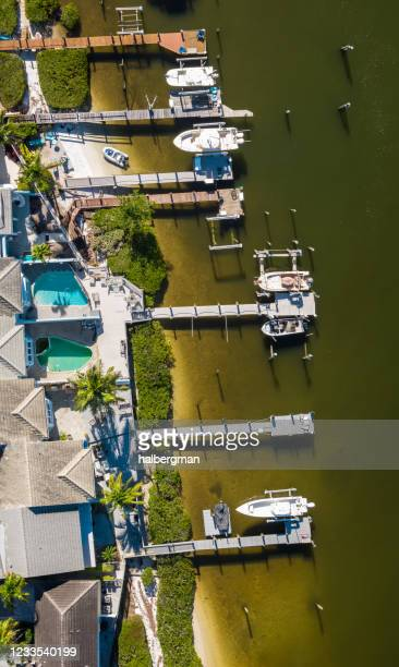aerial panorama of jupiter harbour docks and houses - jupiter florida stock pictures, royalty-free photos & images
