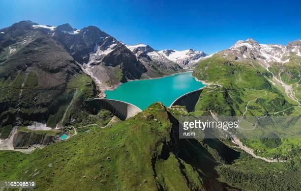 aerial panorama of kaprun high mountain reservoirs mooserboden stausee dam in the hohe tauern, salzburger land, austria. - reservoir stock pictures, royalty-free photos & images