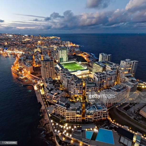 aerial panorama of sliema resort at sunset, valetta, malta - peninsula stock pictures, royalty-free photos & images