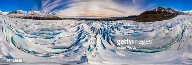 360° aerial panorama of svinafellsjokull glacier in iceland at sunset.  aerial view - panoramica a 360 gradi foto e immagini stock