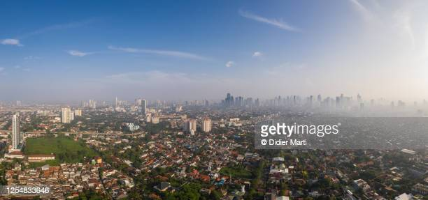 aerial panorama of the jakarta skyline in indonesia capital city. - demography stock pictures, royalty-free photos & images