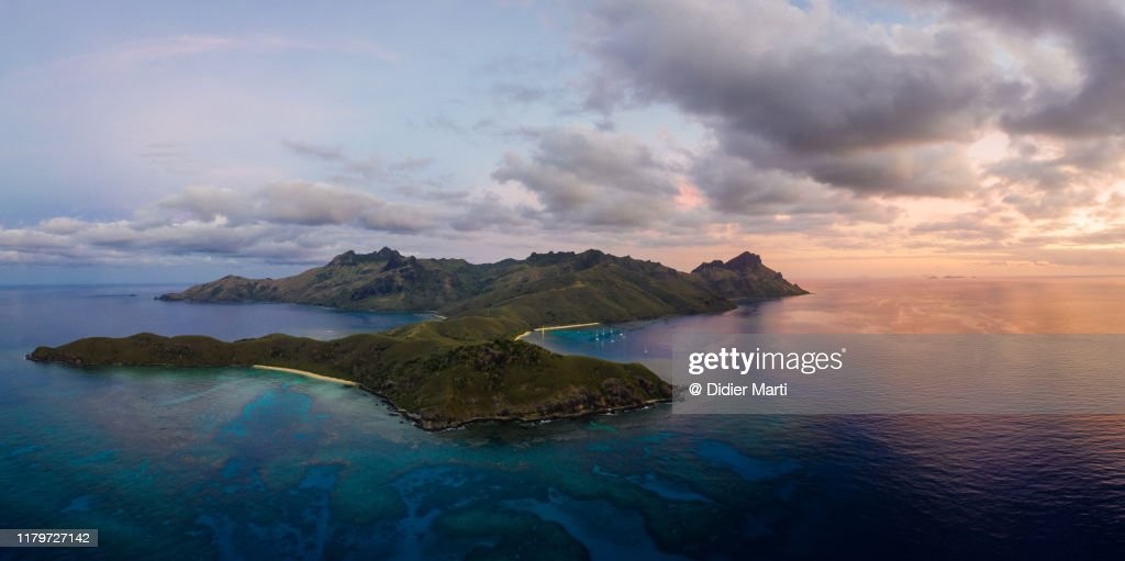 Aerial panorama of the sunset over the Waya island in Fiji : Stock Photo