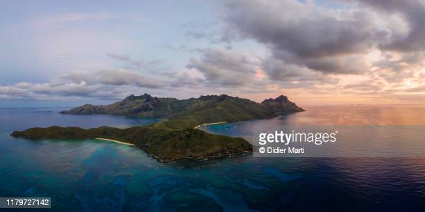 aerial panorama of the sunset over the waya island in fiji - fiji stock pictures, royalty-free photos & images