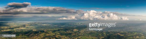 Aerial panorama over country farms fields and towns