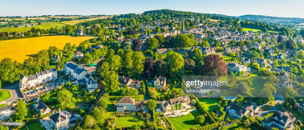 Aerial panorama over country homes in picturesque summer village Cotswolds : Stock Photo
