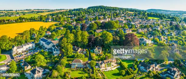 aerial panorama over country homes in picturesque summer village cotswolds - overhemd en stropdas stock pictures, royalty-free photos & images