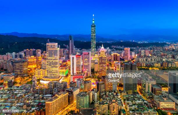 aerial panorama over downtown taipei at night - taipei stock pictures, royalty-free photos & images