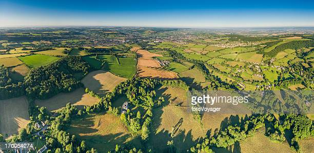 aerial panorama over green fields country villages blue summer skies - overhemd en stropdas stock pictures, royalty-free photos & images
