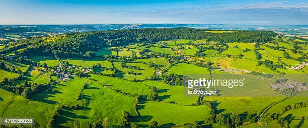 Aerial panorama over green pasture idyllic country villages farms fields