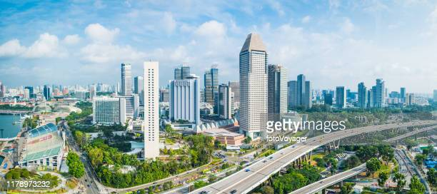 aerial panorama over highrise highways skyscraper cityscape marina bay singapore - singapore city stock pictures, royalty-free photos & images