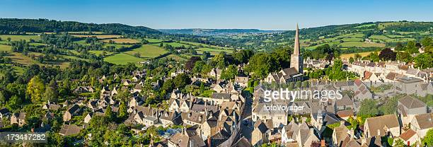 aerial panorama over idyllic country village green fields summer meadows - overhemd en stropdas stock pictures, royalty-free photos & images