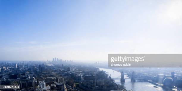 aerial panorama over london city skyline - east london stock pictures, royalty-free photos & images