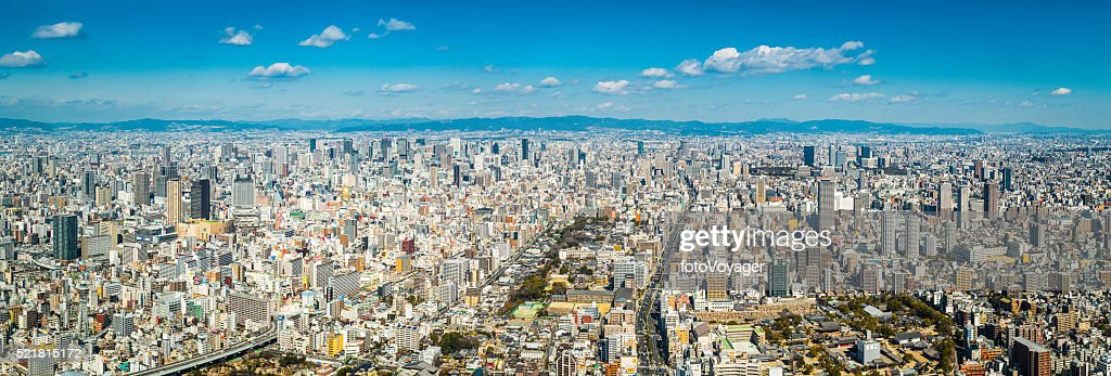Aerial panorama over Osaka crowded cityscape skyscrapers and highways Japan : Stock Photo