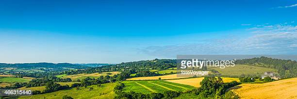 Aerial panorama over patchwork quilt green landscape farms fields villages