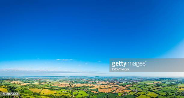 aerial panorama over picturesque green summer landscape big blue skies - clear sky stock pictures, royalty-free photos & images
