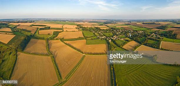 Aerial panorama over rural patchwork quilt of farms crops fields