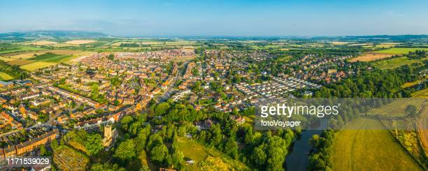 aerial panorama over suburban family homes surrounded by summer countryside - housing development stock pictures, royalty-free photos & images