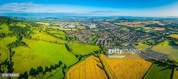 aerial panorama over summer farmland fields pasture country homes suburbs - english culture stock pictures, royalty-free photos & images