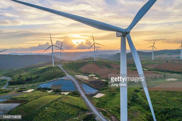 "Aerial panorama view from wind turbine construction in field and meadow on mountain with beauty blue sky sunset""n and cloudy background energy saving concept"