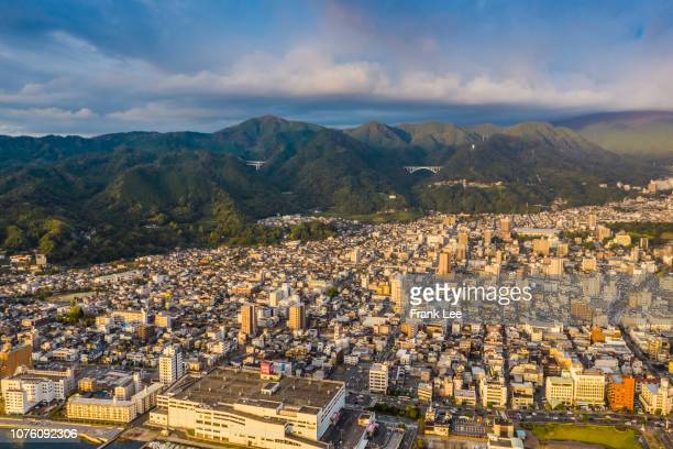 aerial panorama view of beppu cityscape from drone at sunset - 大分県 ストックフォトと画像