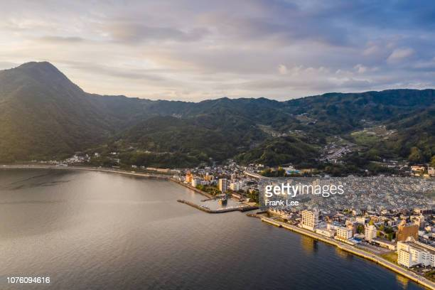 aerial panorama view of Beppu cityscape from drone at sunset